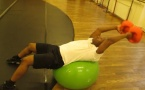 Medecine ball à double poignée